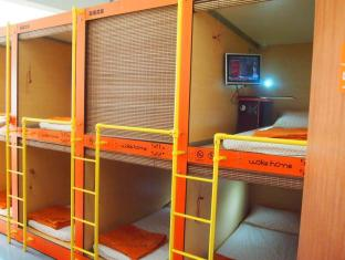 Woke Home Capsule Hostel Singapur - Habitación