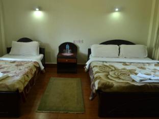 Chitwan Village Resort Chitwan - Kamar Tidur