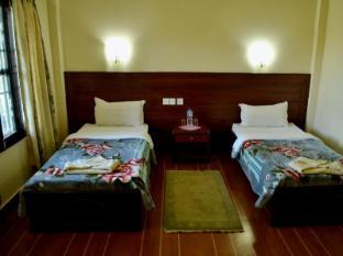 Chitwan Village Resort Chitwan - Gästezimmer