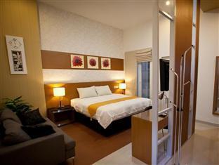 H.O.M.E Guest House Surabaya - Junior Suite
