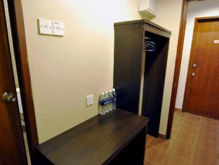 Place2Stay @ City Centre קוצ'ינג - חדר שינה