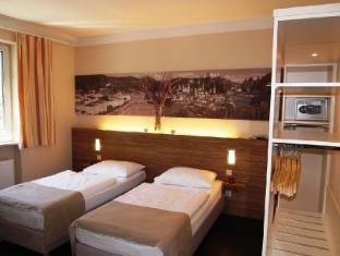 /es-es/altstadt-hotel-hofwirt-salzburg/hotel/salzburg-at.html?asq=jGXBHFvRg5Z51Emf%2fbXG4w%3d%3d