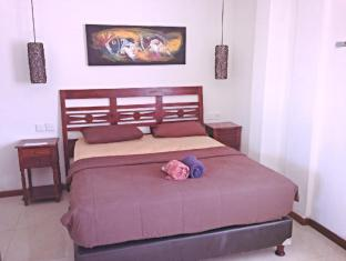 Bemo Corner Guest House Bali - Kamar Tidur