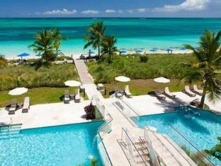 /windsong-resort/hotel/providenciales-tc.html?asq=5VS4rPxIcpCoBEKGzfKvtBRhyPmehrph%2bgkt1T159fjNrXDlbKdjXCz25qsfVmYT