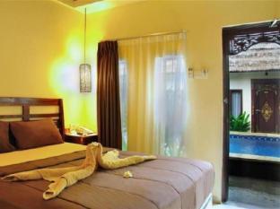 Coco de Heaven Hotel Bali - Kamar Tidur