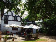 South Africa Hotel Accommodation Cheap | front entrance of tudor house inn