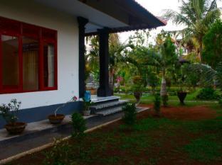 Swan Inn Bali - Hotellihuone