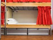 Bed op een Slaapzaal met 8 Bedden