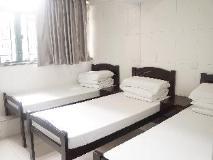 Fuk Hua Travel House: triple bedroom - 3 single beds