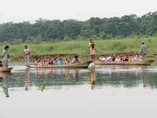 Chitwan Safari Camp & Lodge Chitwan - Canoe Ride inside National Park
