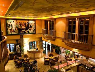 默迪卡宫酒店和套房 古晋 - 餐厅