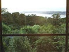 Beach House, 16 Upper Wainui Road | New Zealand Budget Hotels