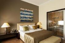 Dvoulůžkový pokoj s manželskou postelí typu Deluxe