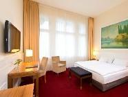 Dvoulůžkový pokoj typu Deluxe s manželskou postelí