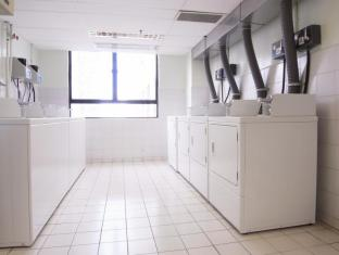 B P International Hotel Hong Kong - Self-Service Laundry Room at 13/F