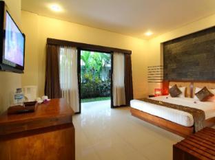Putri Ayu Cottages Bali - Külalistetuba