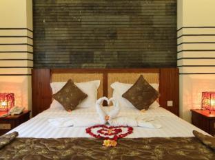 Putri Ayu Cottages Balis - Svečių kambarys