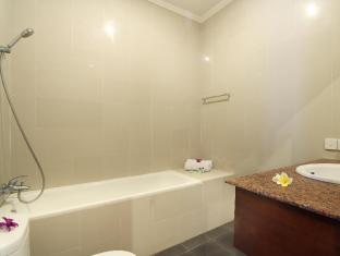 Putri Ayu Cottages بالي - حمام