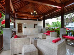 Putri Ayu Cottages Бали - Лоби