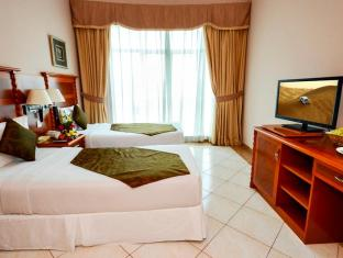Grand Midwest Hotel Apartments Dubai - Bedroom in Apartment